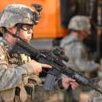 A soldier carries a M4 Carbine rifle. Photo: Army.