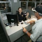Unidentified traveler submitting a fingerprint at a Customs and Border Protection workstation. Photo: CBP