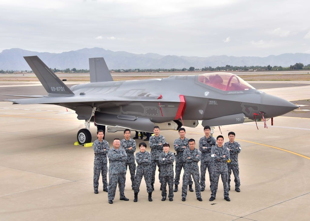 Japanese Air Self-Defense Force maintainers pose for a photo Nov. 28 during the arrival of the first Japanese F-35A at Luke Air Force Base Ariz. (U.S. Air Force photo by Tech. Sgt. Louis Vega Jr.)