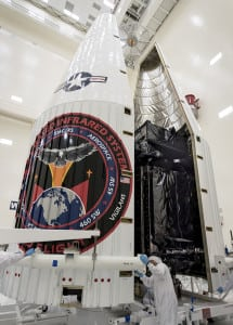 Lockheed Martin employees encapsulate the Air Force's SBIRS GEO 3 satellite before its launch. Photo: Lockheed Martin.