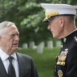 Secretary of Defense Jim Mattis speaks with U.S. Marine Gen. Joseph Dunford, Chairman of the Joint Chiefs of Staff, before a Memorial Day ceremony at Arlington National Cemetery in Arlington, Va., May 29, 2017. (DOD photo by U.S. Air Force Tech. Sgt. Brigitte N. Brantley)
