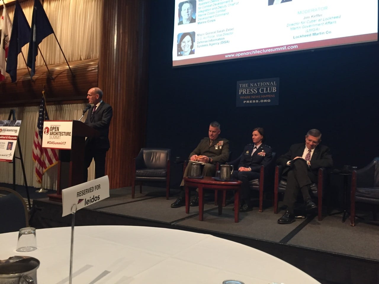 Jim Keffer, Director of Cyber at Lockheed Martin Government Affairs, introduces the  General Officers Panel at Defense Daily's 2017 Open Architecture Summit at the National Press Club in Washington, D.C.