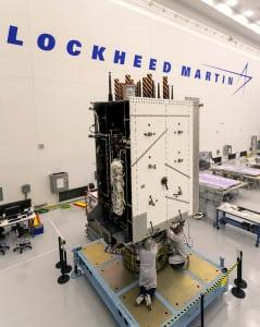 Technicians work on the the U.S. Air Force's third GPS III satellite. (Credit: Lockheed Martin)