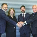 (Left to Right) Domingo Castro, Indra Defense Systems Director; Lockheed Martin VP Michele Evans; Indra Defense and Security general manager Manuel Escalante; and Lockheed Martin VP Brad Hicks shake hands after signing the Heads of Agreement. (Photo: Lockheed Martin)