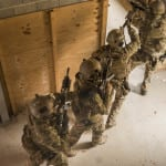 Green Berets assigned to 1st Battalion, 10th Special Forces Group (Airborne), enter and clear a room during a Special Forces Advanced Urban Combat (SFAUC) training exercise near Stuttgart, Germany, Nov. 16, 2017.  The SFAUC exercise tests the Green Berets' ability to lead direct action strikes in urban areas.  Urban combat is a skill 10th Group routinely trains on with multinational Special Operations partners. (U.S. Army photo by Spc. Christopher Stevenson)