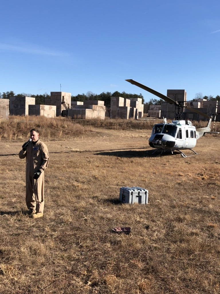 Test Pilot Jason Jewell discusses his experience with manning the UH-1H during its autonomous resupply mission with Aurora Flight Sciences' AACUS system. (Photo by Amy Kluber, Rotor and Wing International)
