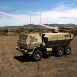 An artist's rendering of Dynetics' High Energy Laser Tactical Vehicle Demonstrator (HEL TVD) in action, designed to counter UAS, rockets, artillery, and mortars for the Army. (Image: Lockheed Martin)