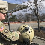 Col. Greg Coile, PEO-C3T project manager, discussing the Transportable Tactical Command Communication system. Photo: Matthew Beinart.