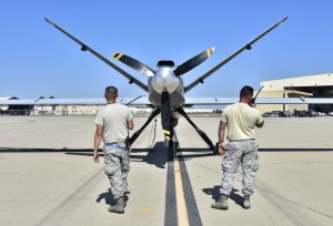 Members of the 163d Aircraft Maintenance Squadron,163d Attack Wing, California Air National Guard, conduct a preflight check on the wing's MQ-9 Reaper remotely piloted aircraft before a fire support mission, Aug. 1, 2018, at March Air Reserve Base, California. (U.S Air National Guard photo by Airman 1st Class Michelle J. Ulber)