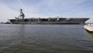 USS Gerald R. Ford (CVN-78) is maneuvered by tugboats in the James River during Ford's turn ship evolution during its post-shakedown availability in March at Huntington Ingalls Industries-Newport News Shipbuilding. (Photo: U.S. Navy)