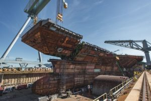 The upper bow unit superlift is lowered into the dry dock on July 10 and placed on the future aircraft carrier John F. Kennedy (CVN-79). (Photo: Ashley Cowan/HII)