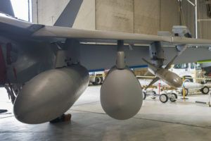 One of the first pictures of the Raytheon Next Generation Jammer Mid-Band pod installed on an EA-18G Growler. (Photo: Raytheon)