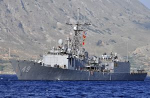 The guided-missile frigate USS Robert G. Bradley (FFG-49) conducts a berth shift during a port visit to the island of Crete on May 13, 2013. Since then the ship was decommissioned and is being refurbished and sold to Bahrain as a Foreign Military Sale. (Photo: U.S. Navy)